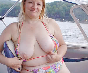 Chubby mature nudist boaters naked or almost naked