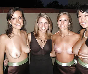 Lots of happy young girls flashing together in the night