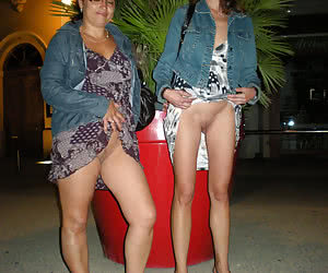 Semi-nude and nude MILFs flashing in a night city