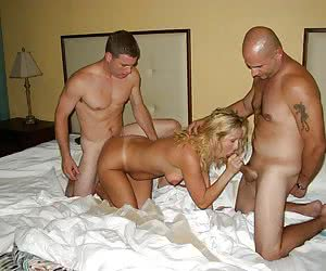A brunette in anal MMF threesome shots