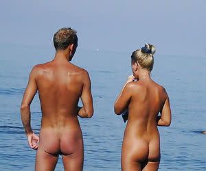 Young amateur nudists outside