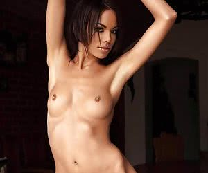 Skinny brunette poses naked