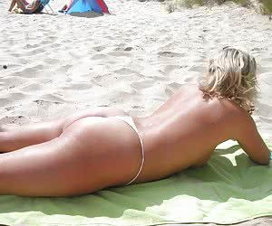 Photos of ordinary babes readily showing off their thongs