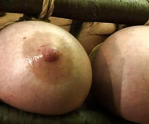 woman tortures her own big tits