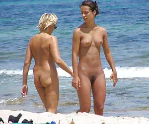 A tanned girl going topless on the La Joya Nude
