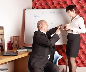 The boss and secretary are discussing the forthcoming meeting, his mind is wandering as he looks at her bra through her