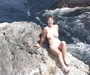 My girlfriend's hot chubby body can turn on these rocks not only me shooting her nude.