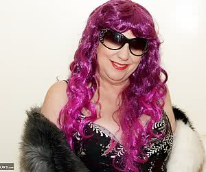 Heres Auntie Trisha all dressed in Purple complete with her Purple Wig, and shes on the bed and its time to shoot a hot