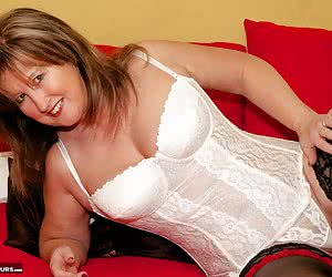 Hi Guys Im Teezer and Im on the bed in my White Retro Basque Stripping and Playing just for you in this photo set shot b