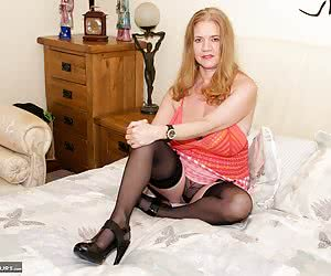 Time for a Hot Photoshoot with The Dirty Doctor and Im on the bed in my Knitted Orange top and Red cheque skirt and not