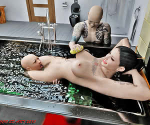 Mrs. Adzumi, boss of Yakuza, teaches two young members of his clan discipline and obedience.