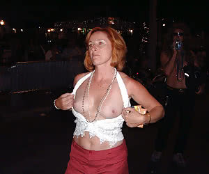 Mature flashers with a bodypaintings at a night parade