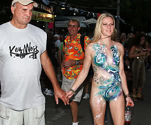 Nudist mature bodypainting at a sexy night party
