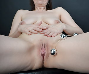Great game in the photo studio with my love balls.My Silver Balls are again into my cunt.And my cameraman holds with the