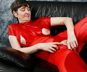 In red lacquer bodysuit on the sofa.The Tits unpacked little bit and laid my pussy free for Show.Extra for you.