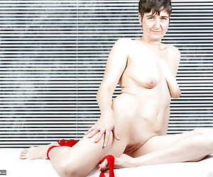 In the finest underwear, nylons and heels.I love everything in red.