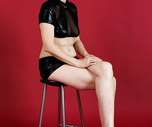 In the studio in the outfit consisting of wetlook.Top and Skirt.Both just and quickly filed the strip on the stool.So I