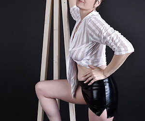 In wetlook skirt and a thin Blouse.Seems almost everything through the Blouse.Well and under the Skirt I have nothing.No