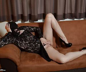 Posing in a hot outfit with mask on the couch.My photographer wanted anything unusual to you.There, but the outfit is pe