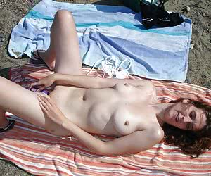 nudist women likes to pose on a beach