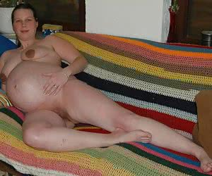amateur pregnant babe posing and milking