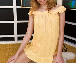 Stunning young beauty getting out of her sexy yellow nighty