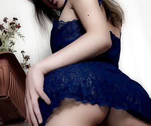 Young Juliana taking off her sexy blue nighty and posing nude on the balcony