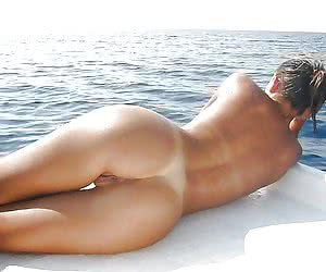 Girls exposing seductive curves of their nude bodies to the warm sun
