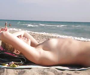 Ordinary amateurs sunning their naked bodies and having fun in the water