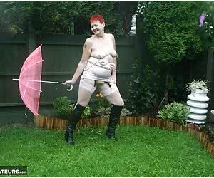 Yes it's still raining in my garden, but I have my tits out.