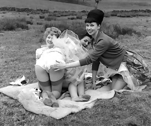 In fits of passion three gorgeous chicks pose in vintage lingerie and show their legs on the nature