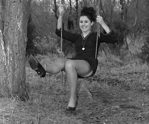 Playful ladies with beautiful smile enjoy posing vintage lingerie before the camera