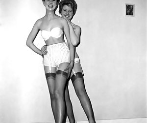 Two neat gals pose in retro lingerie and get their rocks of doing it before the camera now