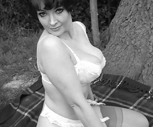 Very hot brunette chick gets her rocks on posing in her favorite retro lingerie on the nature