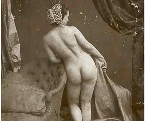Black-and-white photos of vintage woman posing naked.